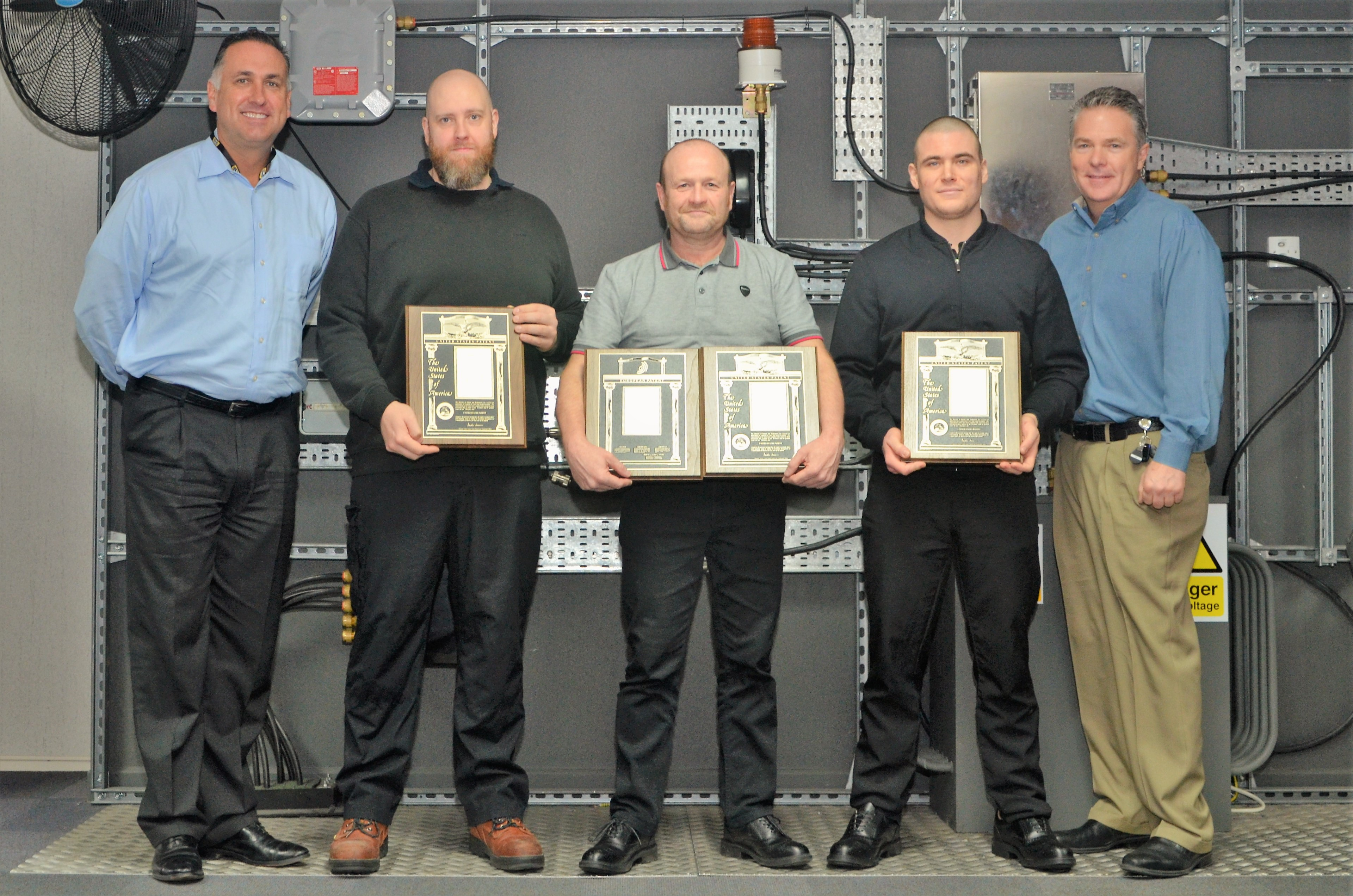 Carl Jackson, Jason Clark and Dean Renshaw are pictured being presented with Hubbell Patent Awards by Warren Jenkins, Vice President and General Manager or Hubbell Inc. and Steve Taafe, Director of Engineering at Killark.