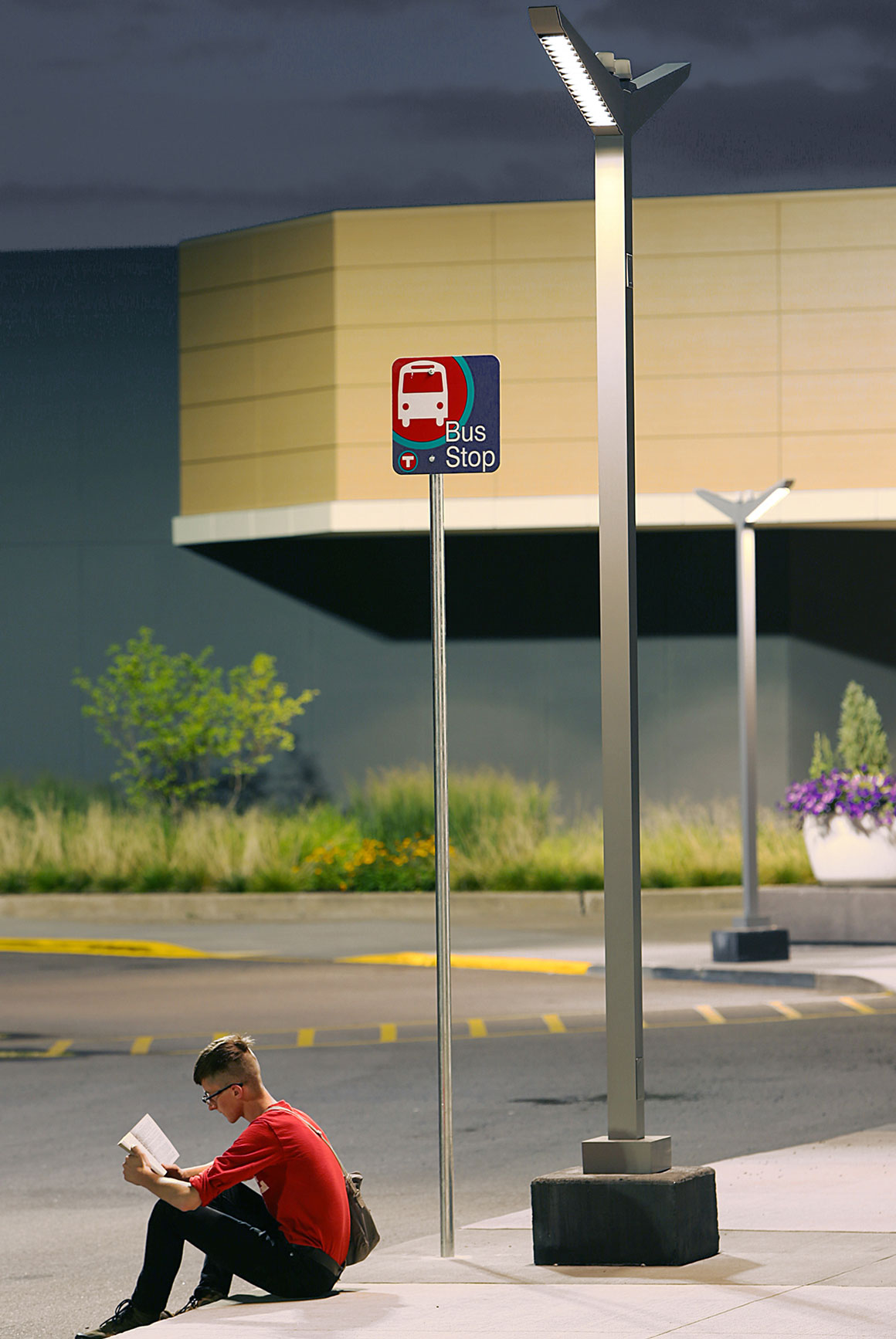 Person waiting for the bus under the illumation of a modern light fixture. & Architectural Area Lighting | Homepage