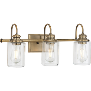 Aiken Collection Three-Light Clear Glass Vintage Style Brass Farmhouse Style Bath Vanity Wall Light